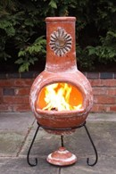 Rustic Orange chimenea with Sun Motif