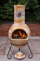 Rustic Yellow chimenea with Sun Motif